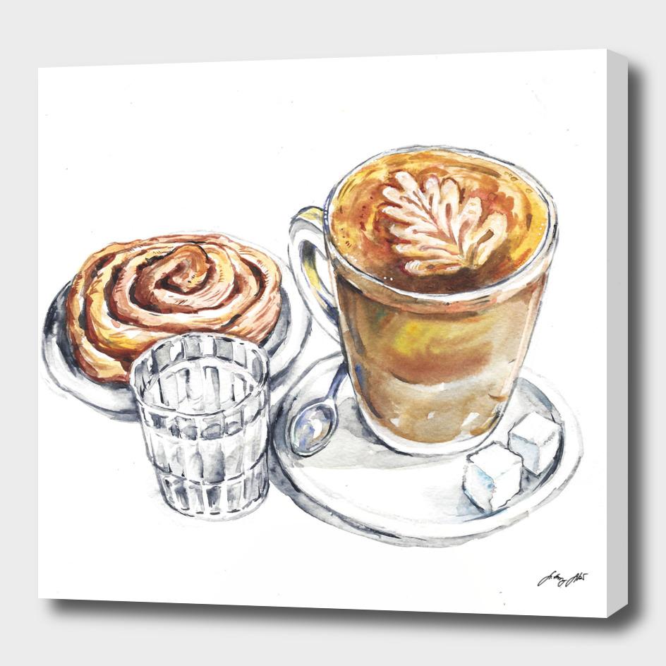 breakfast chinnamon roll and coffee