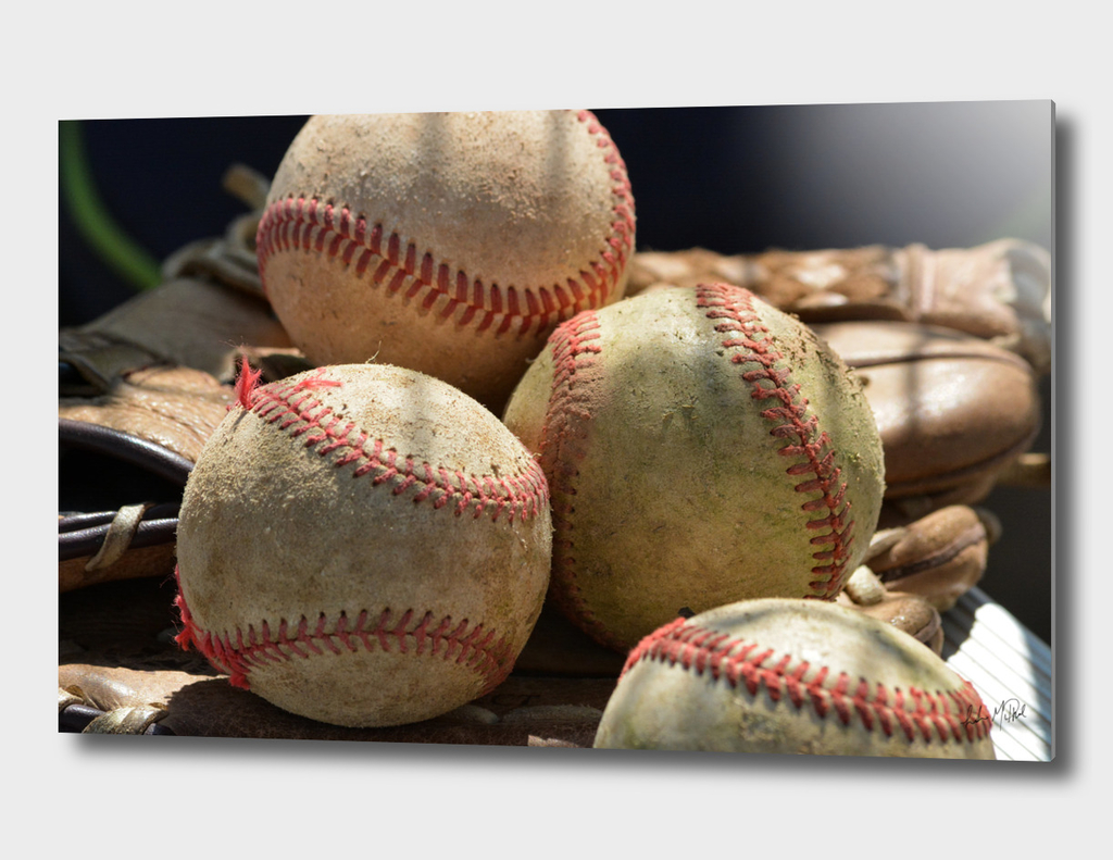 Baseballs and Glove