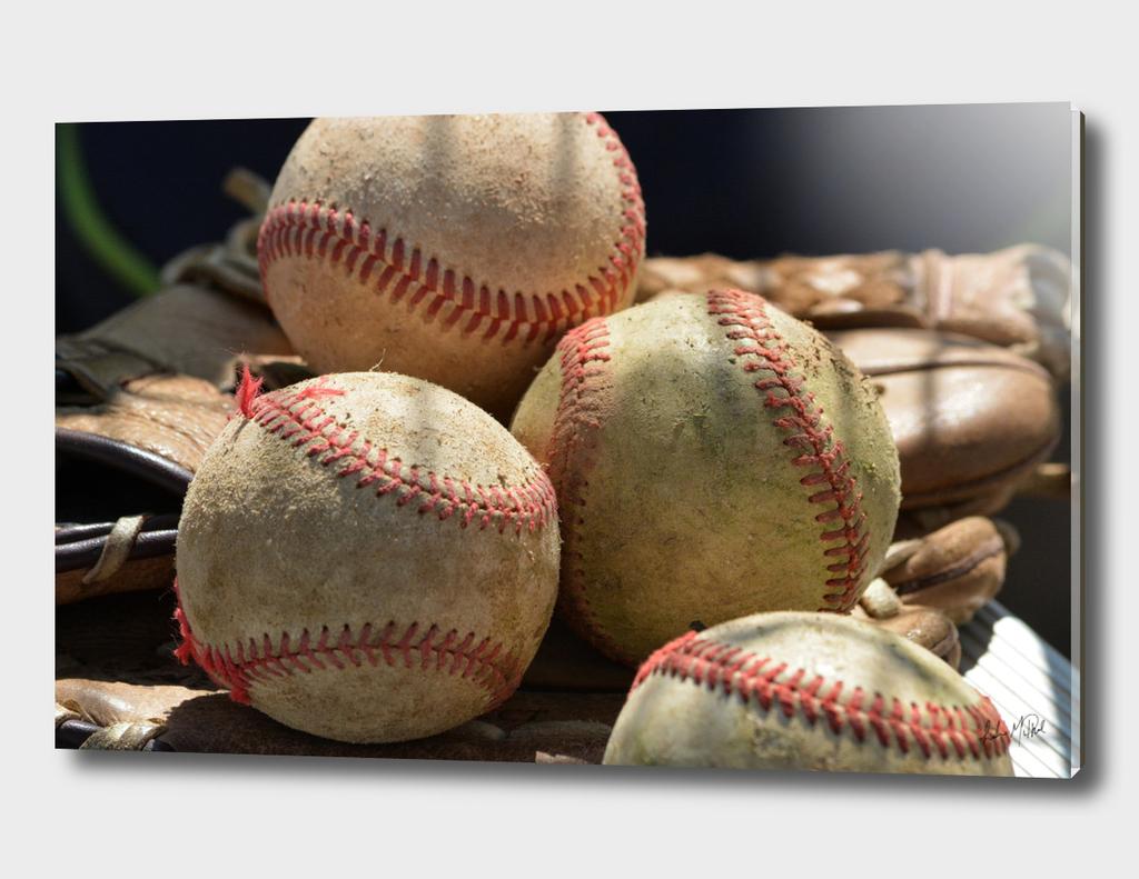 Baseballs and Glove