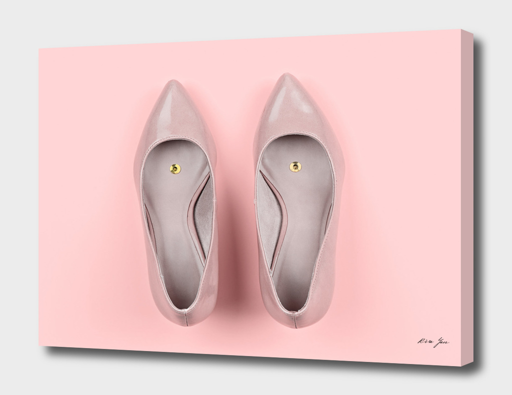 Pair of classic women's beige shoes with pushpin