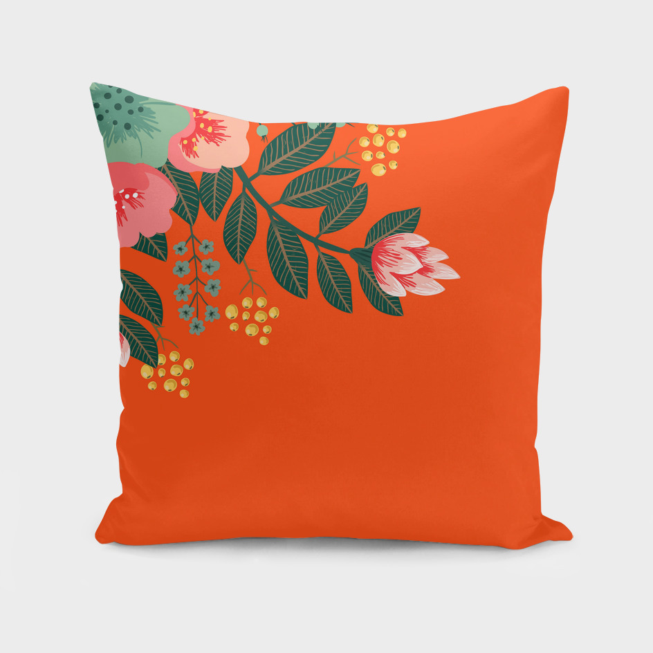 Orange accent throw pillow with tropical flowers