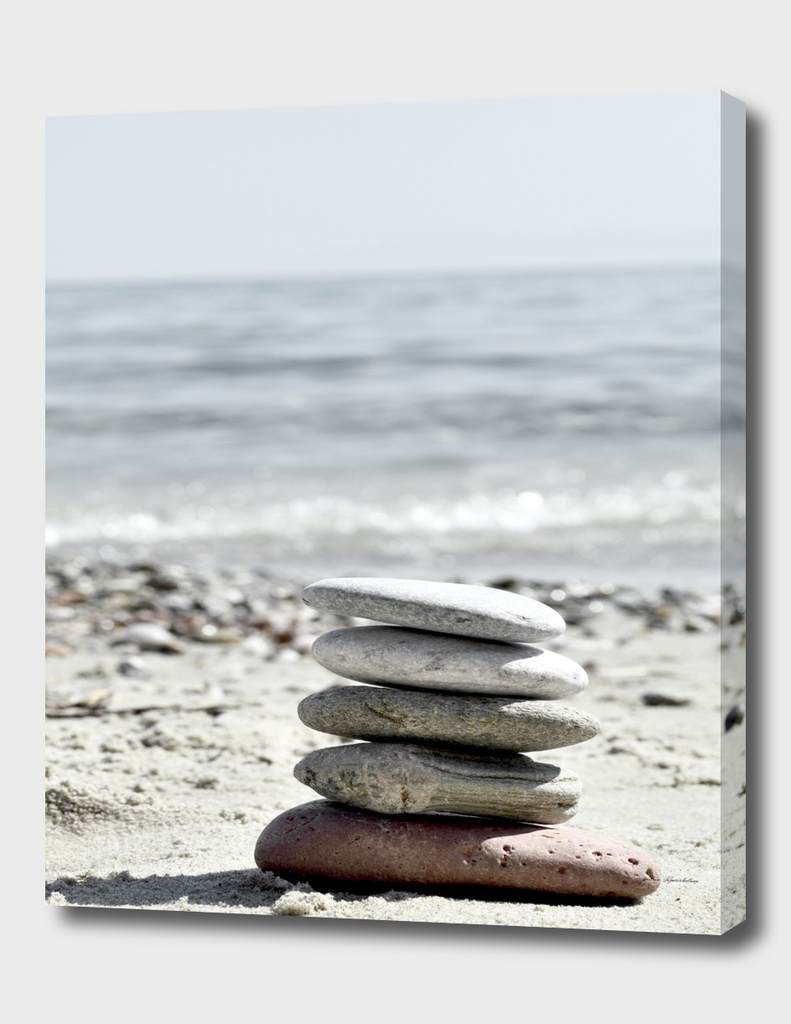Pebble Balance On The Beach