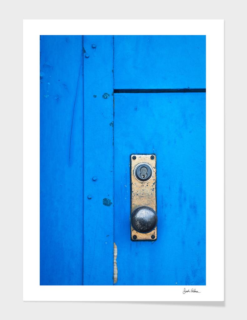 Doorknob on a Blue Door