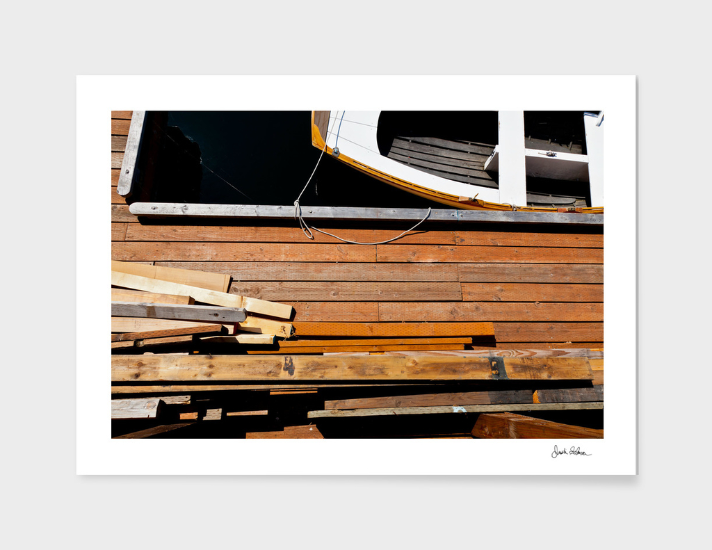 Wood on a Wooden Dock near a Wooden Boat