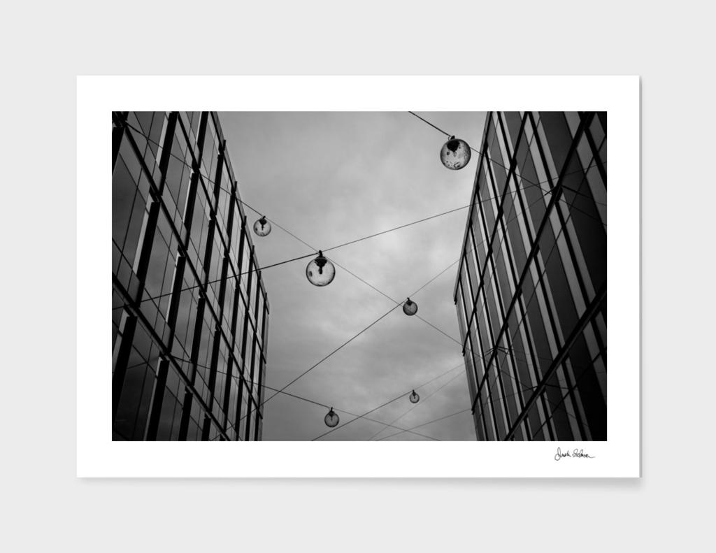 Glass Hanging Lamps Across Buildings