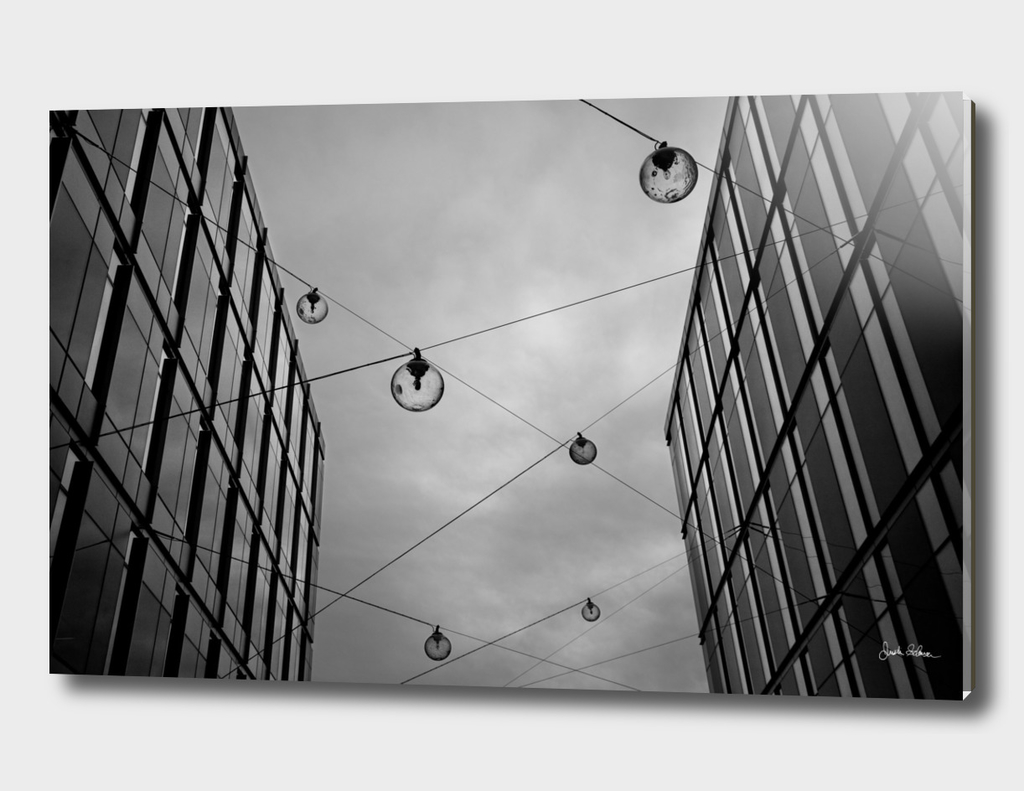 Glass Hanging Lamps Across Buildings