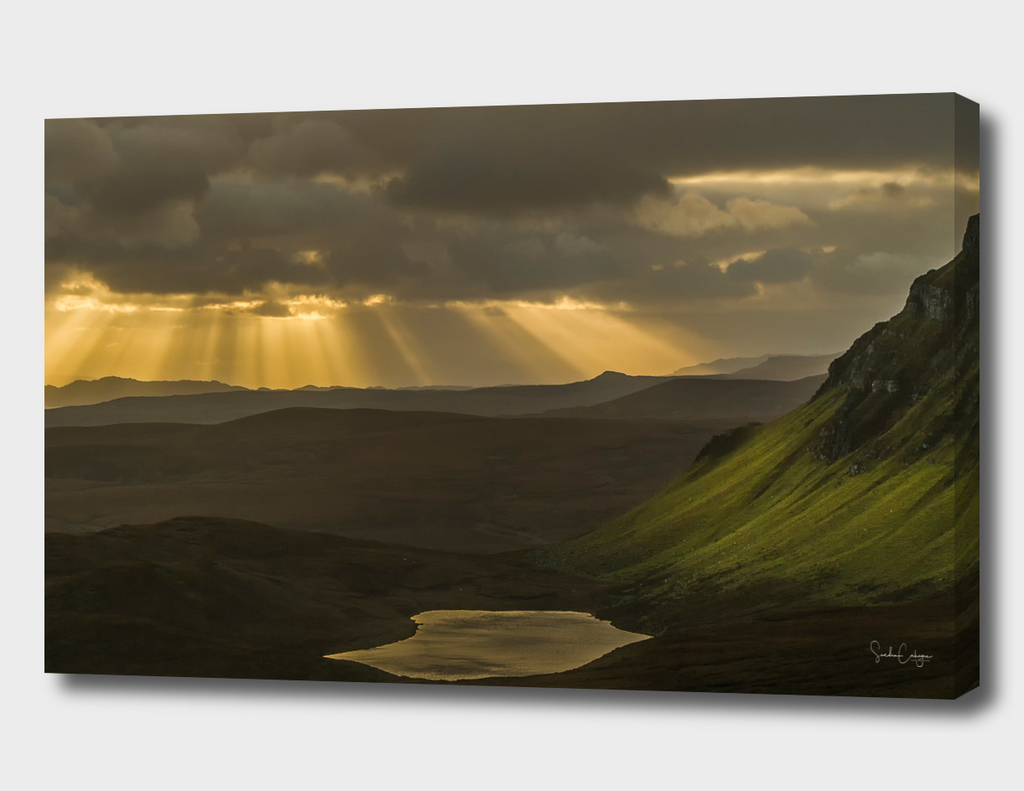 Quiraing heavenly rays. Crepuscular clouds