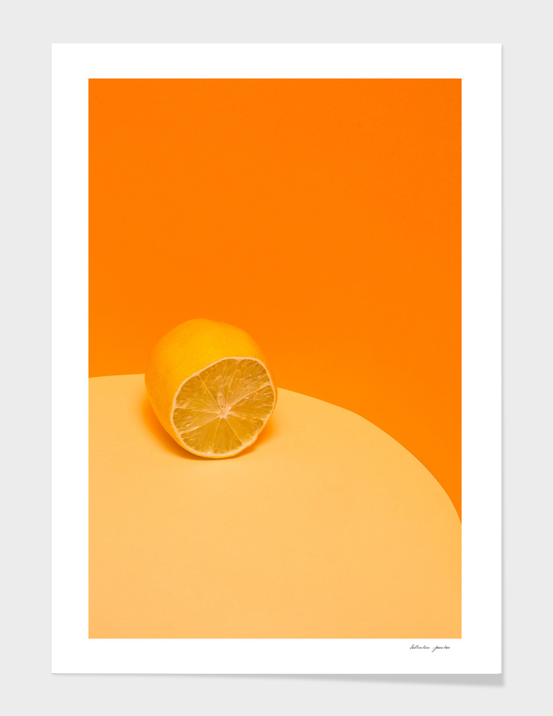 Cut fresh lemon on a yellow-orange background