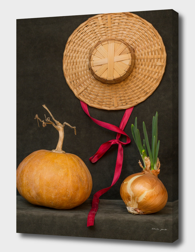 Still life with pumpkin, hat and sprouted onions