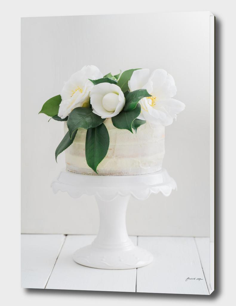 Naked wedding cake with camellias