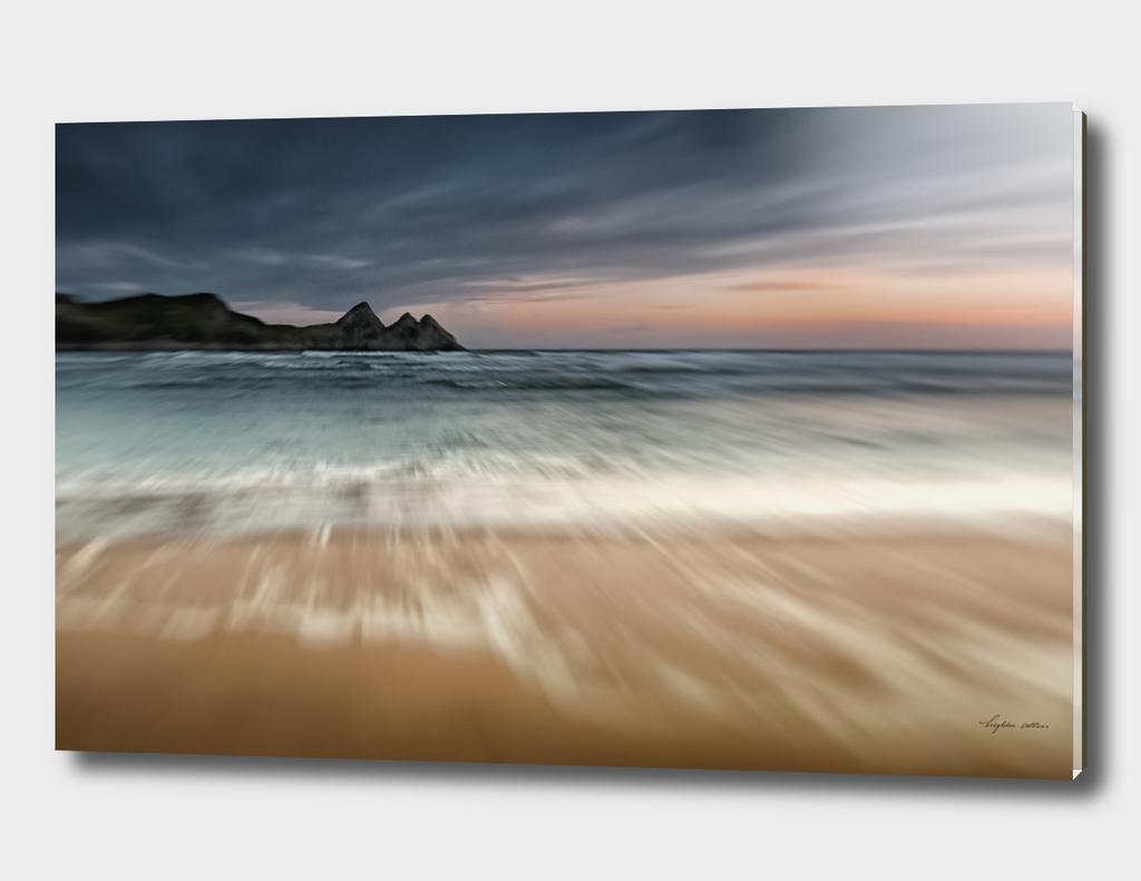 Sunset at Three Cliffs Bay Gower