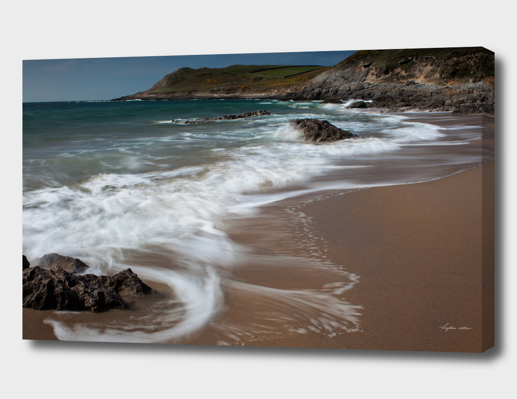 Swirling waves at Fall Bay Gower Swansea