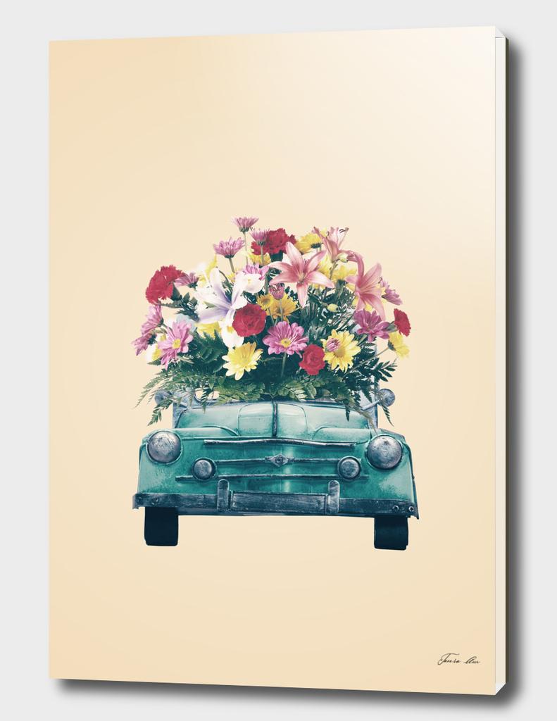 Blue retro car with flowers