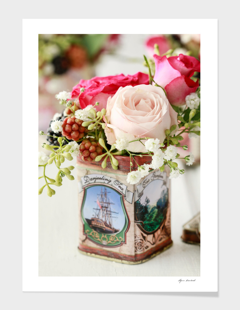 Roses and blackberries in one floral arrangement.