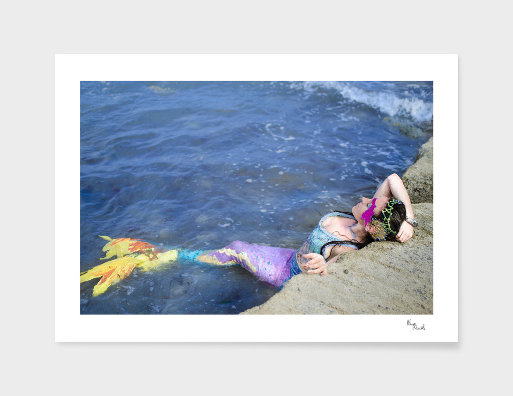 Rainbow Mermaid in the water