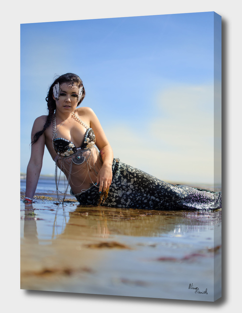 A mermaid on the beach
