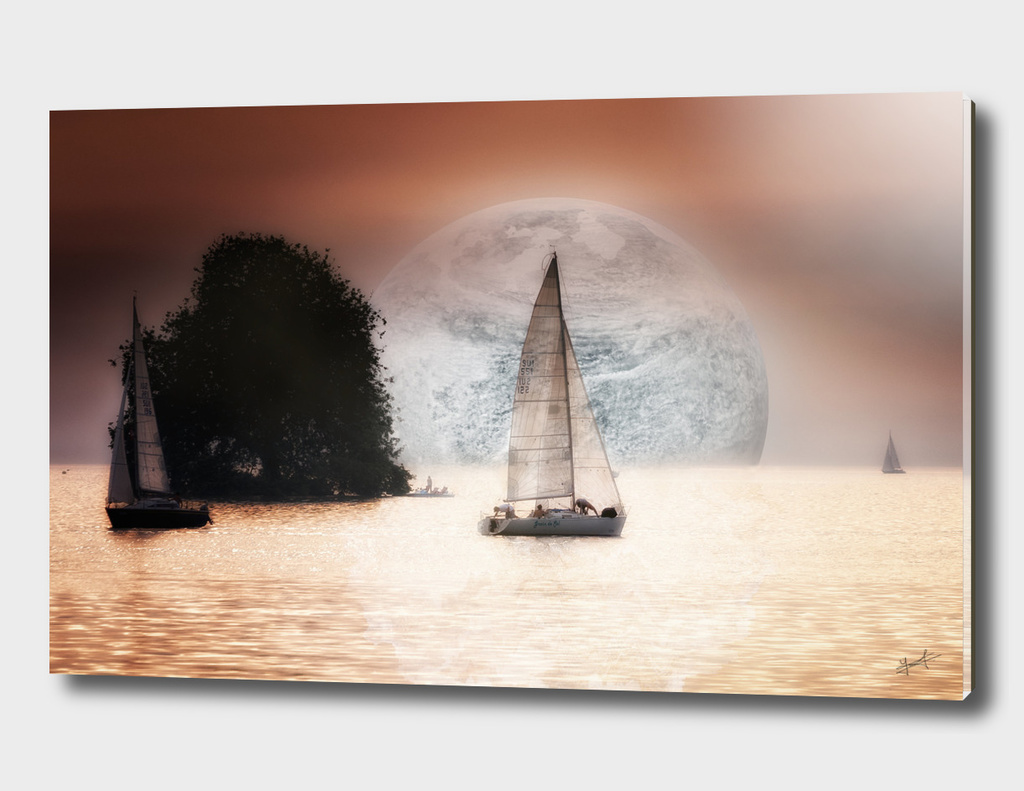 The sailing boat on the lake