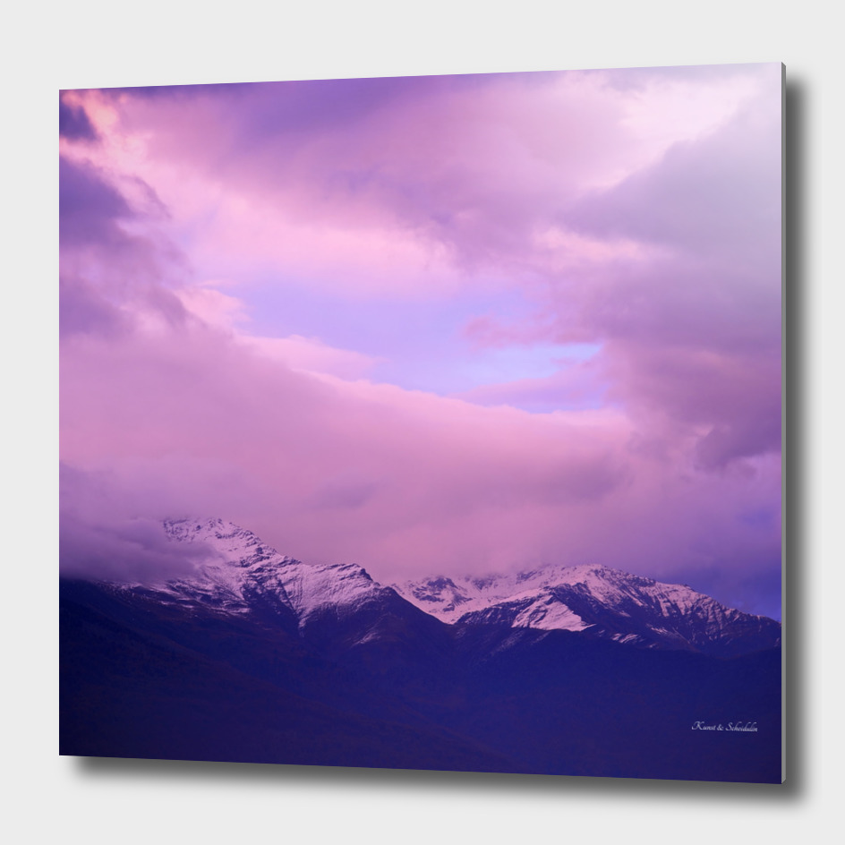 Sunset over snow-capped mountain peaks