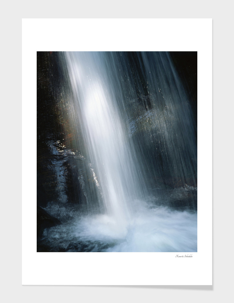 Waterfall illuminated by a ray of sunlight