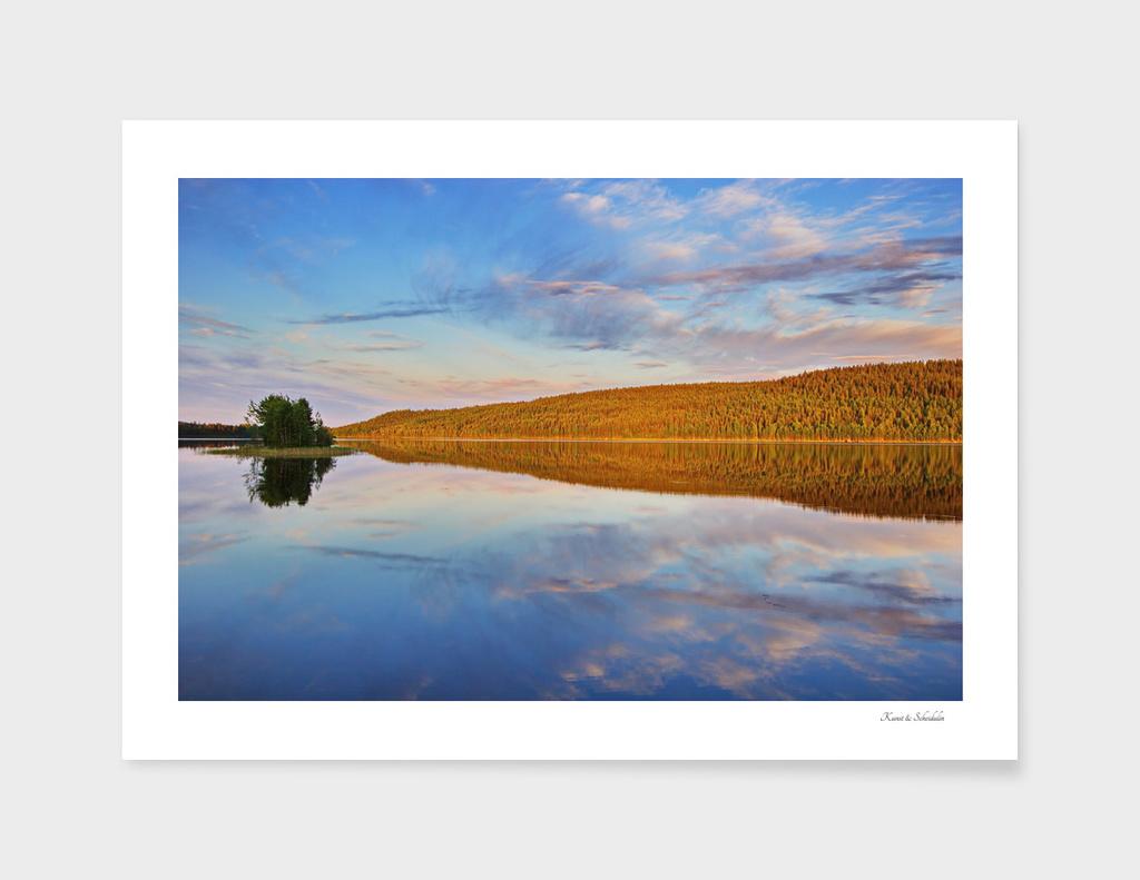 Quiet lake under the midnight sun