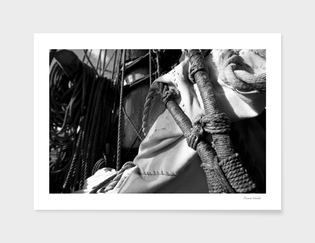 Reefed sail and hemp ropes