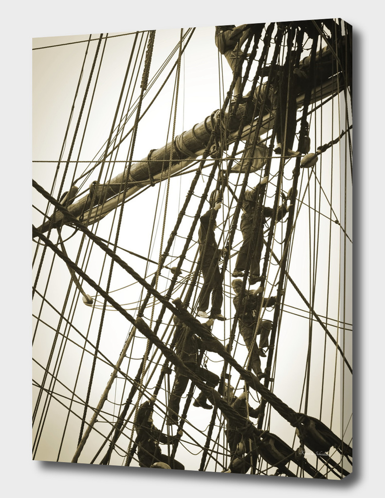 Sailors climbing in the rigging of a tall ship