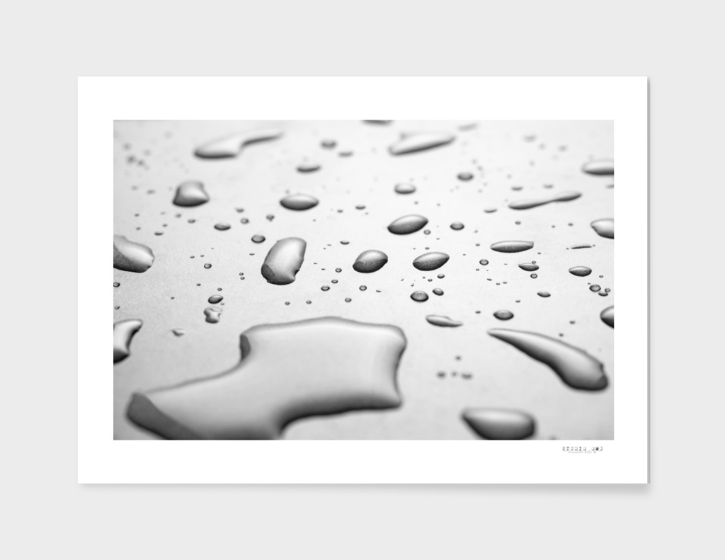 Water drops on the black surface