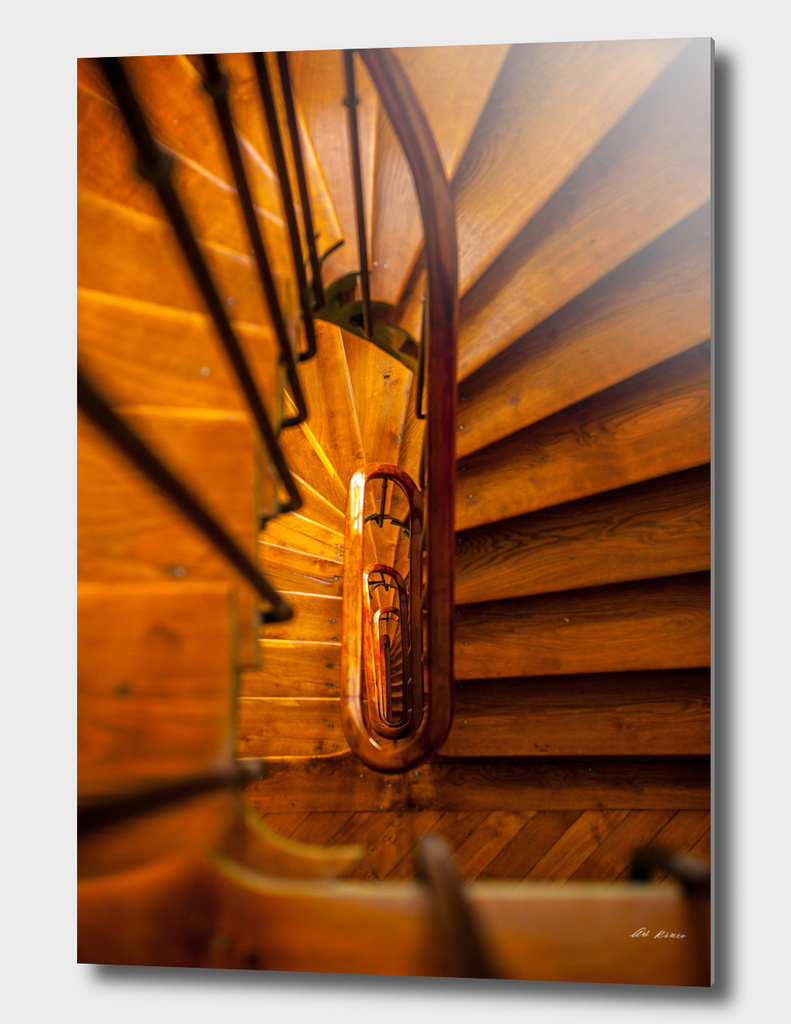 Wooden spiral staircase.
