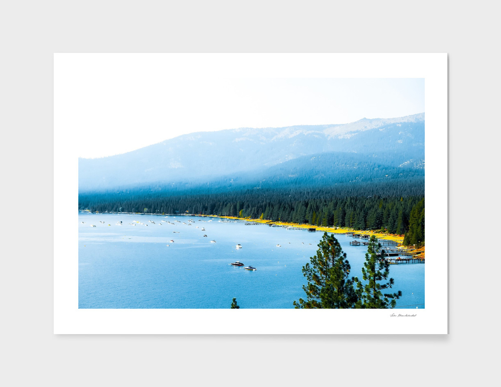 boats on the blue lake with pine tree and mountains