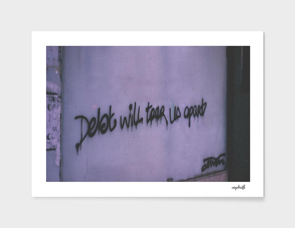 / debt will tear us apart /