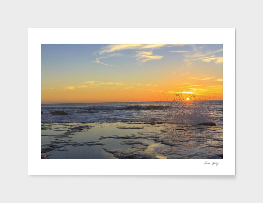Sunset ocean beach cliffs