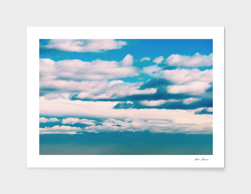 White Soft Clouds On Blue Turquoise Sky