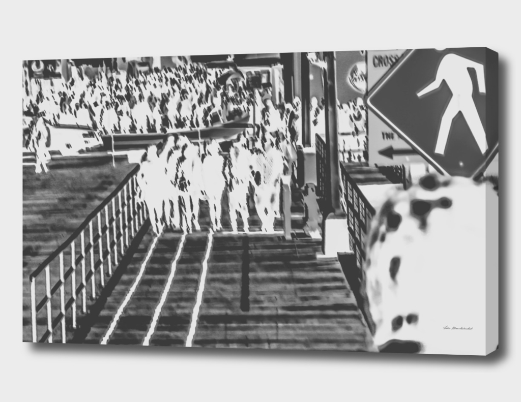 crowded on the wooden walkway in black and white