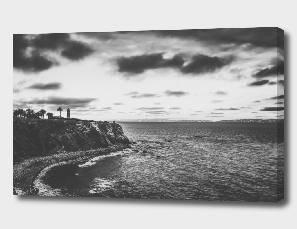 beach sunset with cloudy sky in black and white