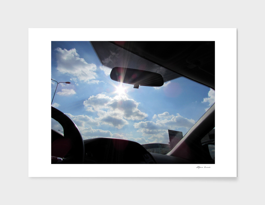 cloudy sky with the sun - travel by car