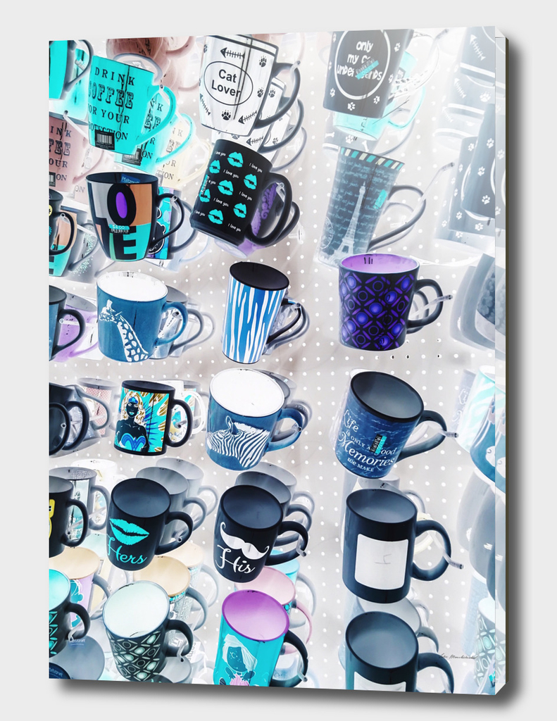 colorful mugs hanging on the white wall