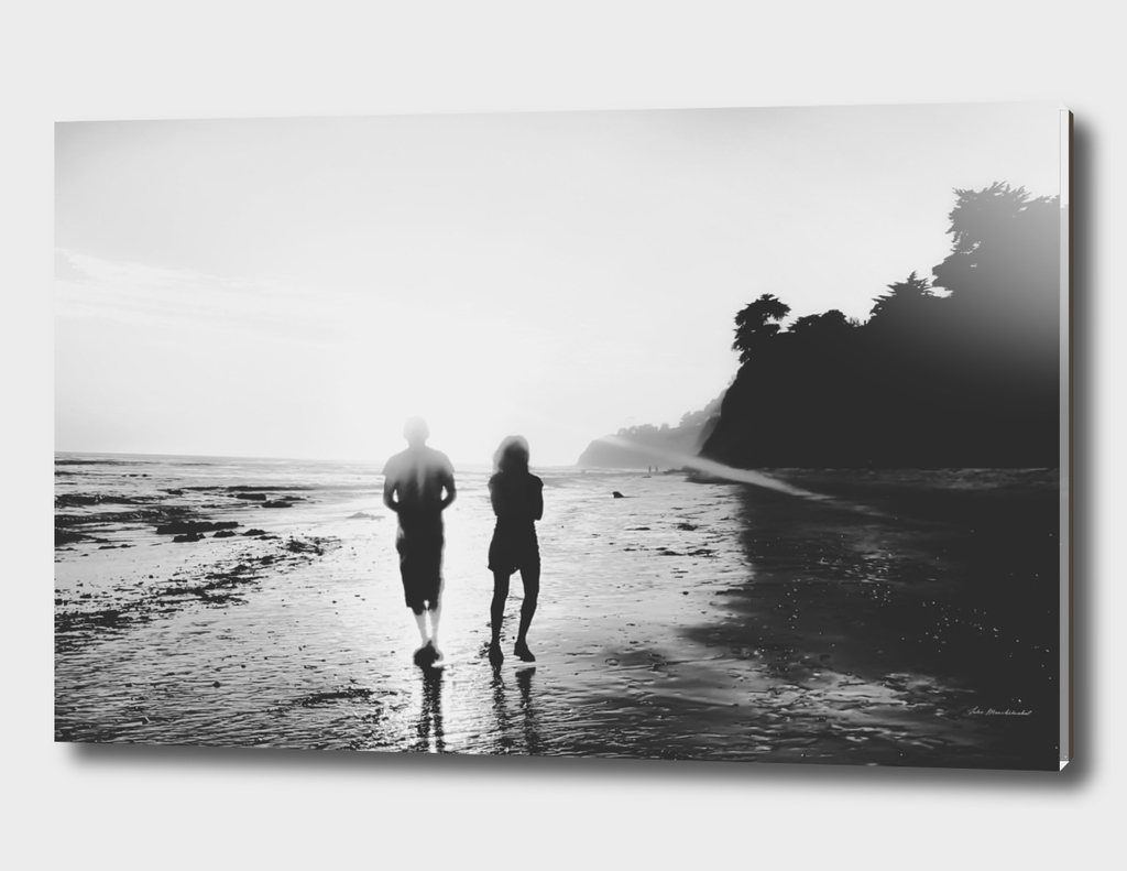 walking on the with sunset light in black and white