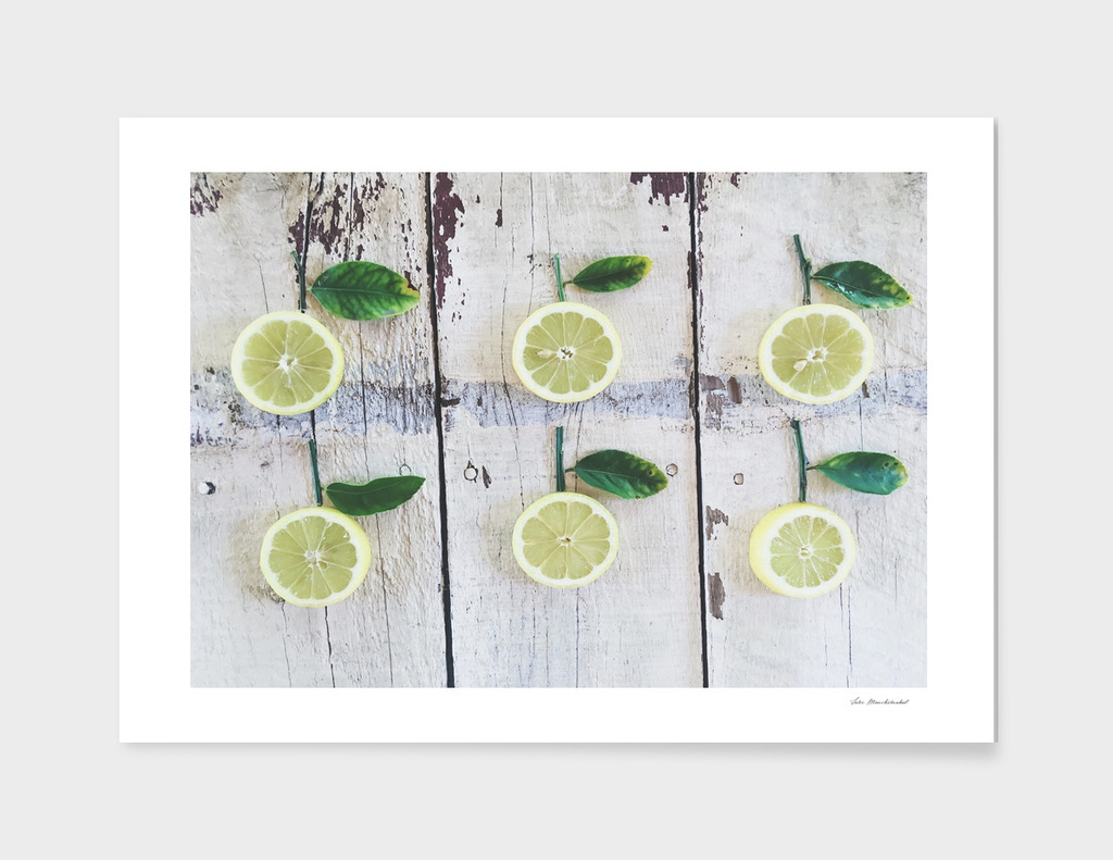 fresh and juicy lemon with green leaf on wooden table
