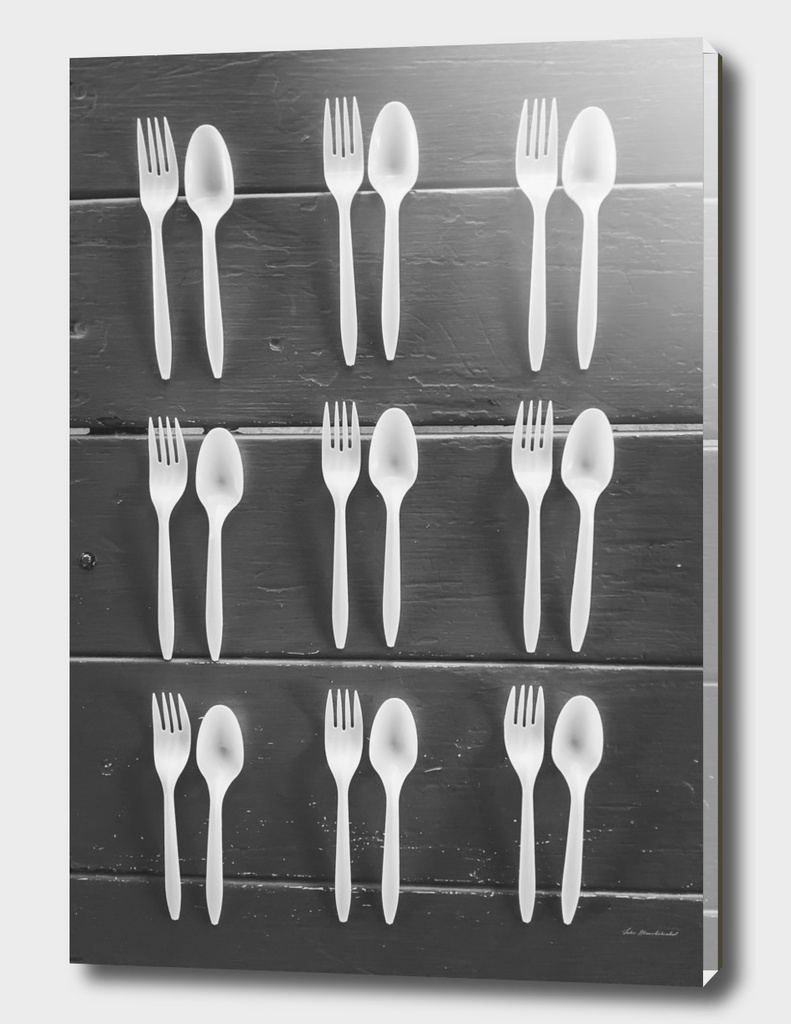 spoon and fork on the wood table in black and white