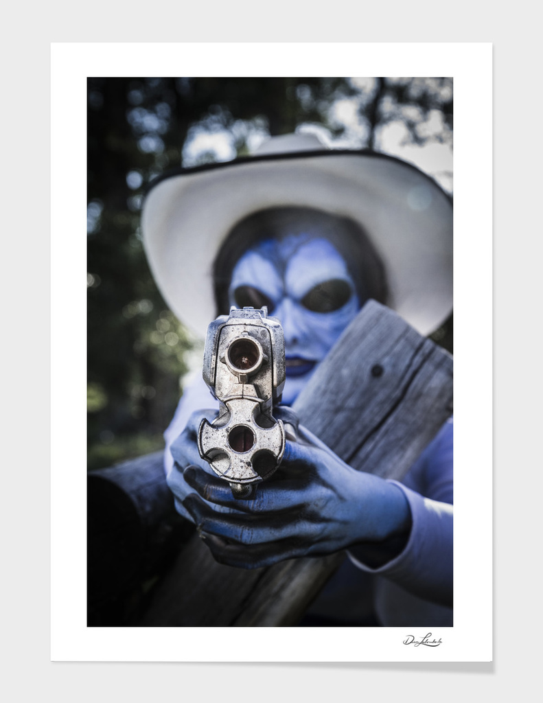 Blue Alien Cowgirl Aiming Her Gun