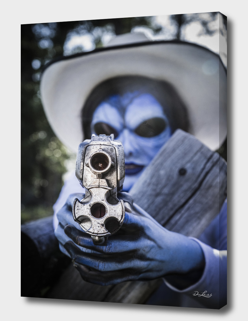 Blue Alien Cowgirl Aiming Her Gun
