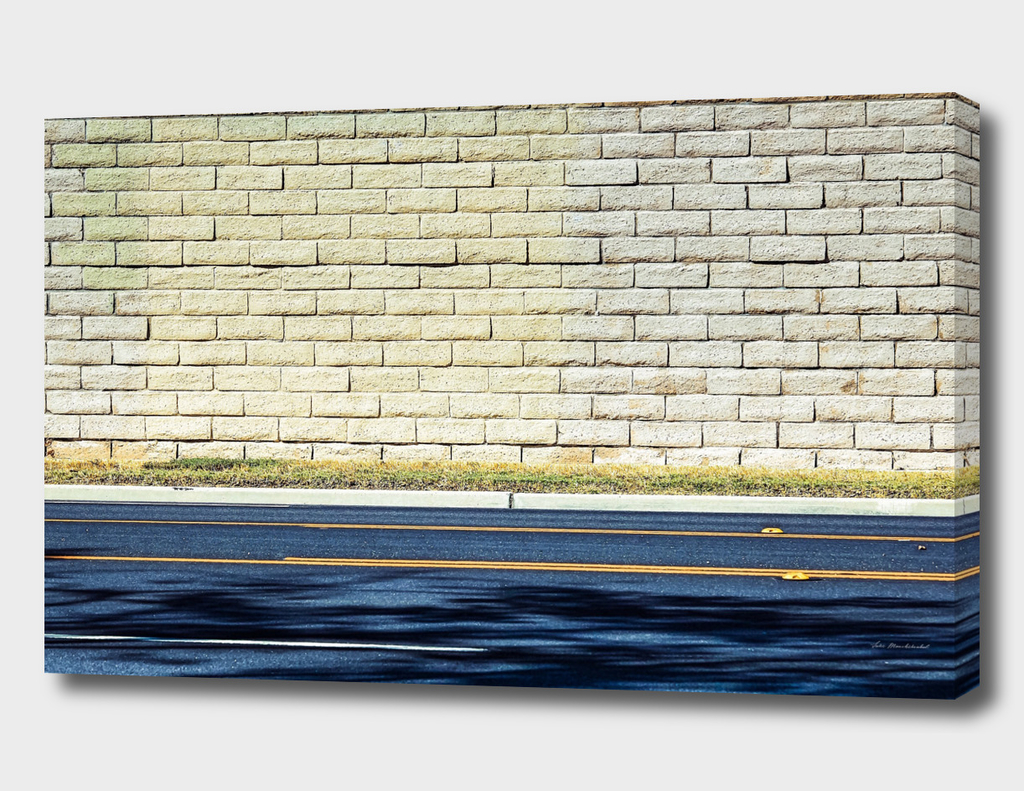 road in the city with brick wall background