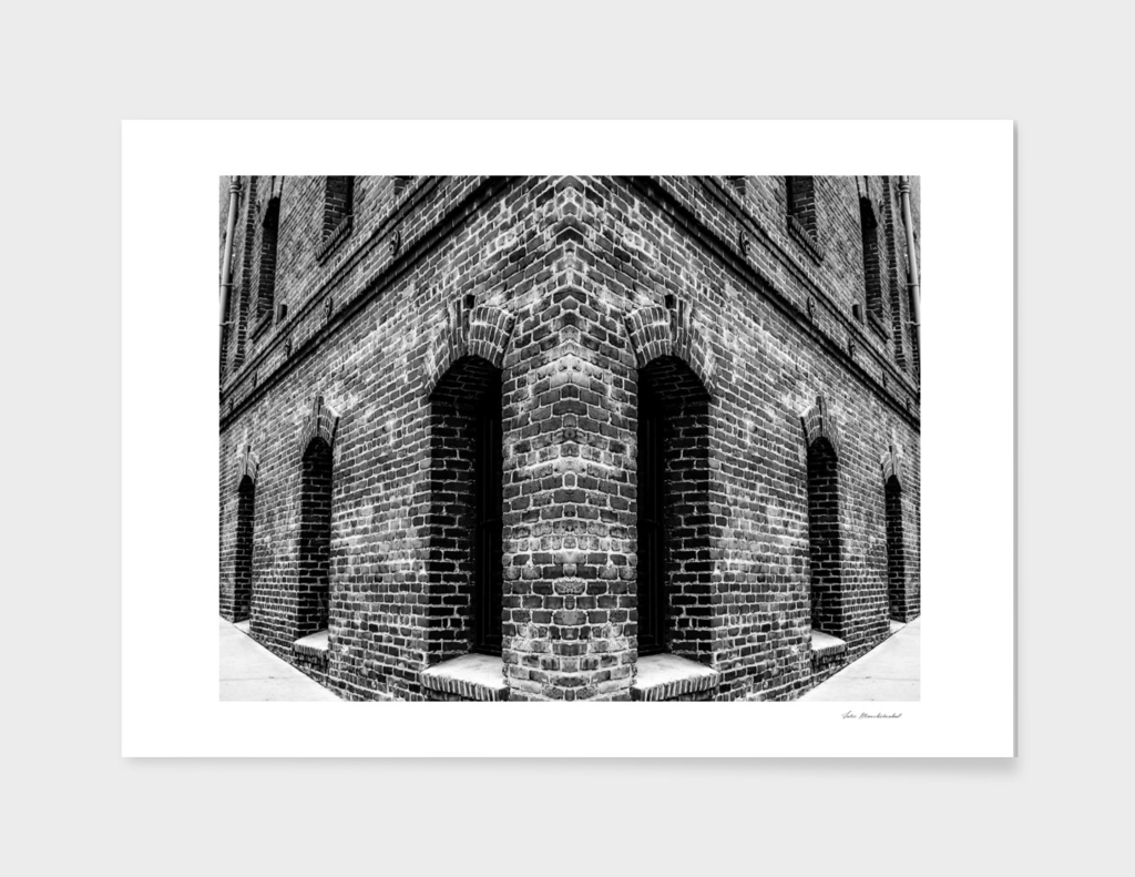 brick building in black and white