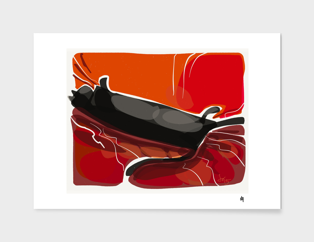 Black cat stretched out on a red couch