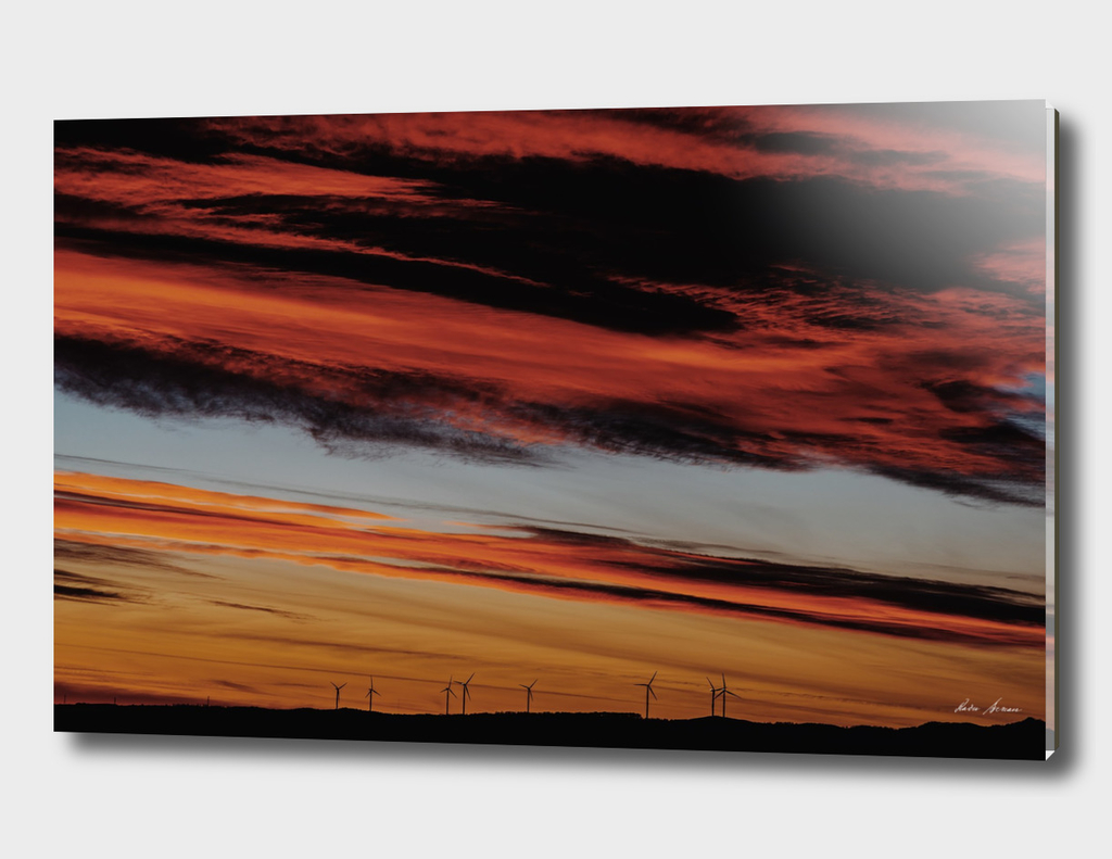 Wind Turbines Farm In The Distance On Beautiful Red Sunset