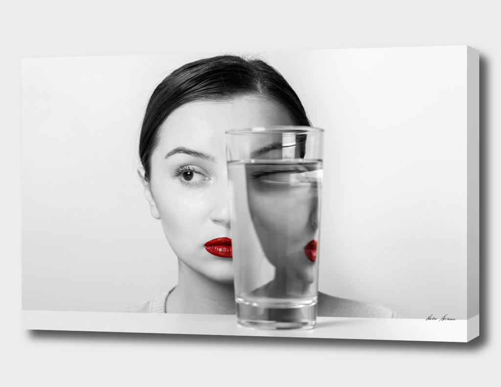 Woman Face Distortion In Glass Of Water
