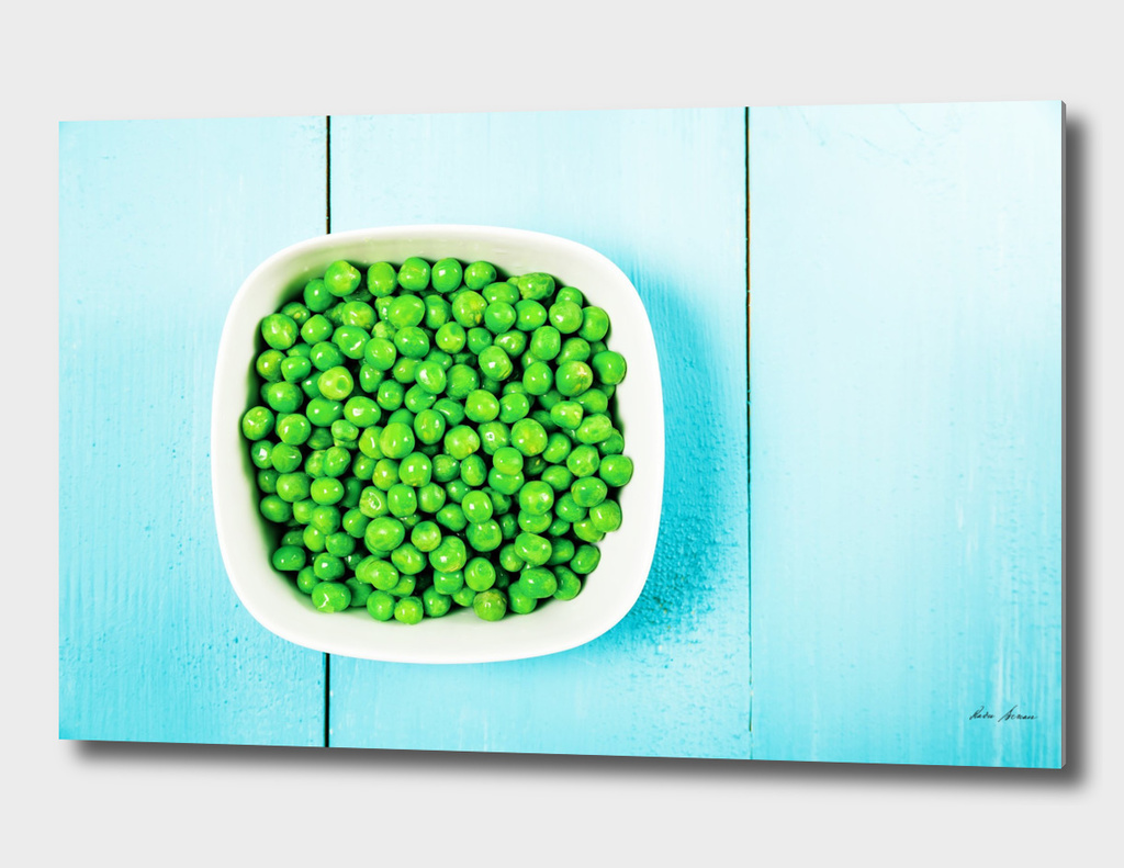 Fresh Green Peas In White Bowl On Turquoise Table