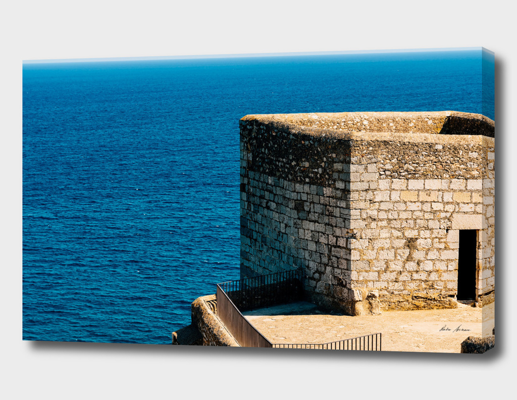 Old Castle Stone Wall And Tower With Ocean Background