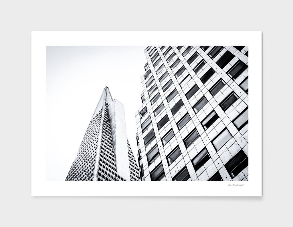 pyramid building and modern building in black and white