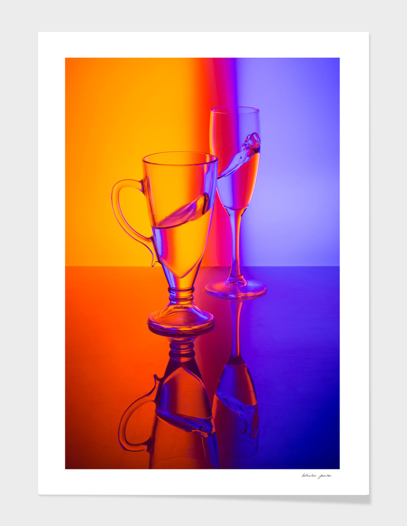 Still life with glass goblets and liquid